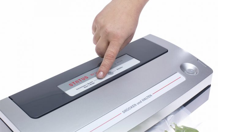 pressing the button on vacuum sealer BV500