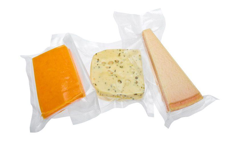 Vacuum packed cheese in vacuum foil roll