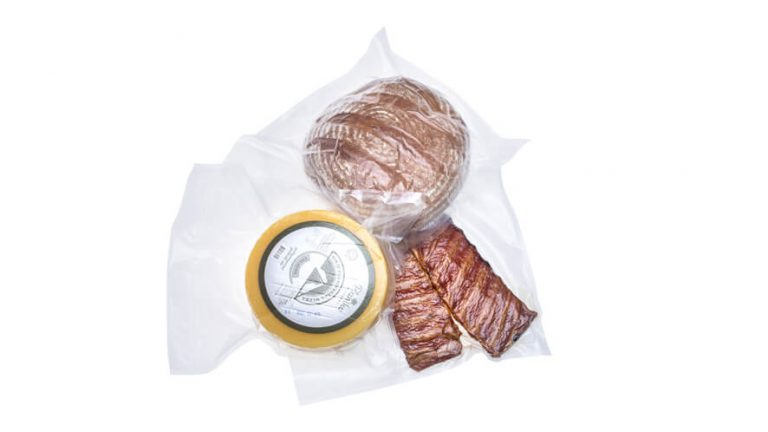 vacuum packed ribs, wheel of cheese and bread